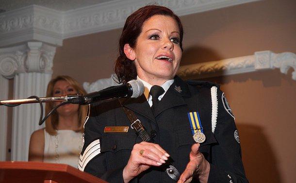 A woman in TPS uniform at a podium