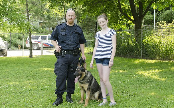 A man in TPS uniform, a dog, and a girl