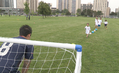A line of children in front of a net