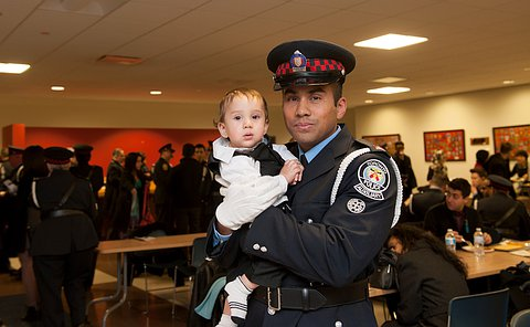 A man in uniform with his baby.