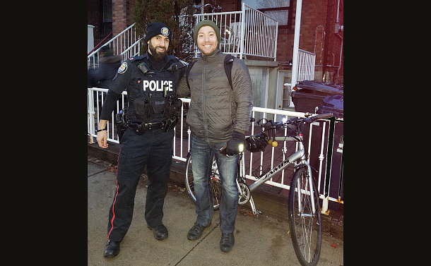 A man in TPS uniform with a cyclist