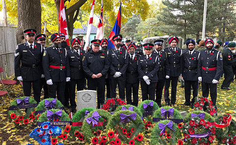 A group of officers at a gravesite