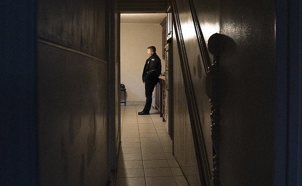 A woman in a hallway