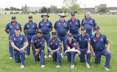 Two rows of men in cricket uniform