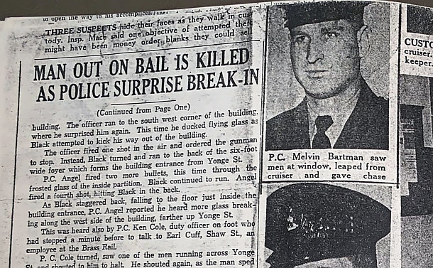 A newspaper with a close up of a man in police uniform