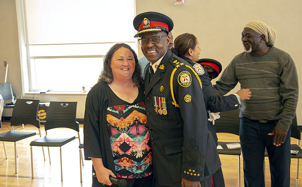 Woman standing next to a man dressed in a police uniform