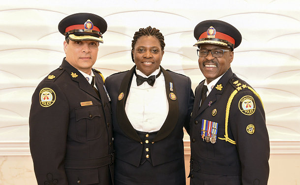 Two men and a women in TPS uniform