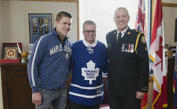 Three men, one in TPS uniform