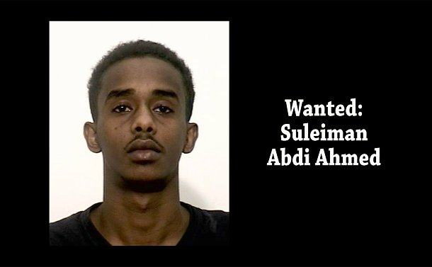 A close up of a man with the words: Wanted: Suleiman Abdi Ahmed
