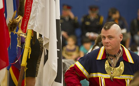 A man looks towards flags