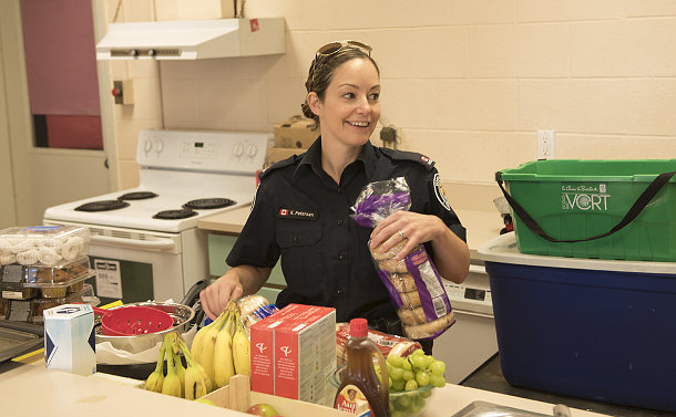 A woman in TPS uniform in a kitchen
