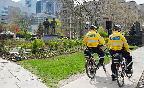 Two TPS officers on bicycles