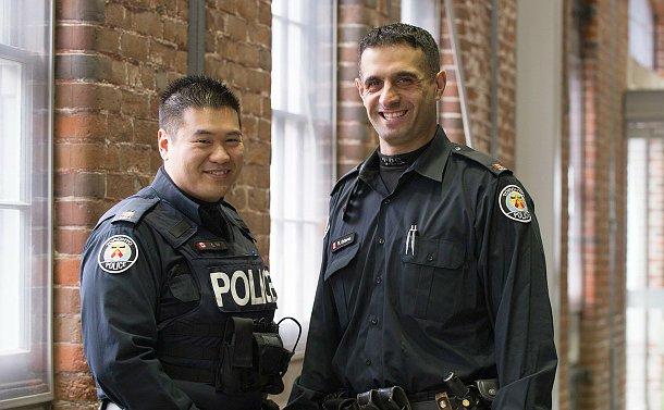 Two men in TPS uniform