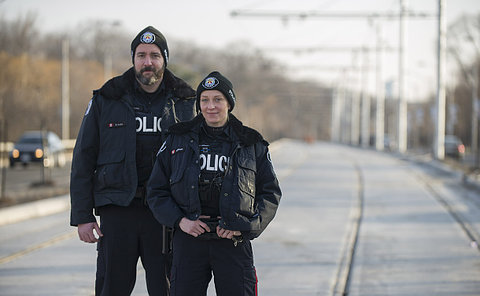 A man and woman in TPS uniform
