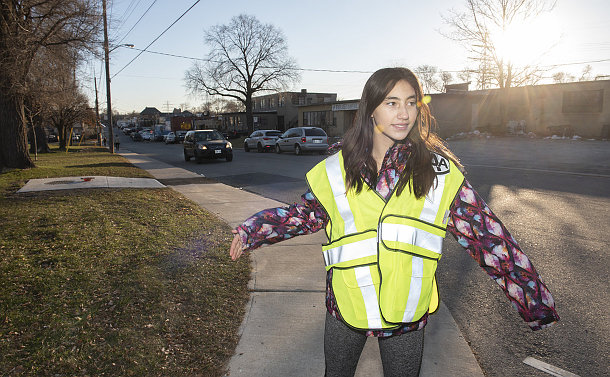 A girl in a yellow vest
