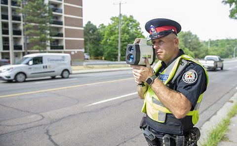 A man in TPS uniform with a radar gun