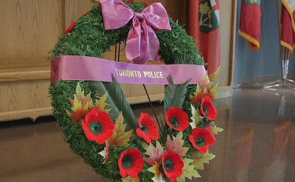 A wreath that says Toronto Police