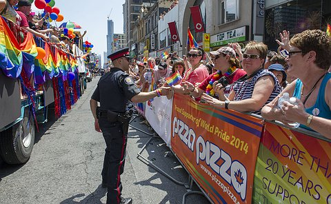 TPS Officer engages the crowd at the 2014 World Pride Parade.