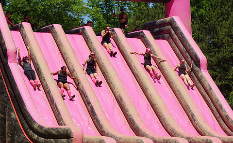 People on an inflatable slide