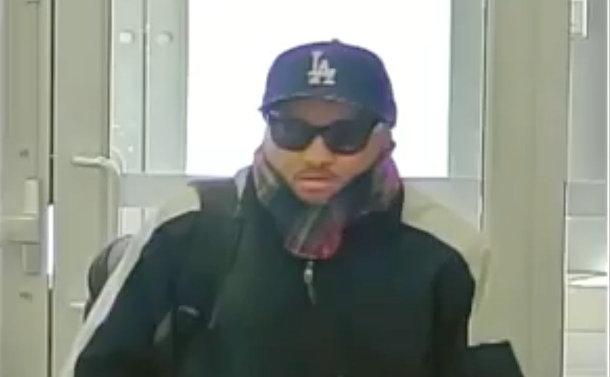 An image of a man in a baseball cap