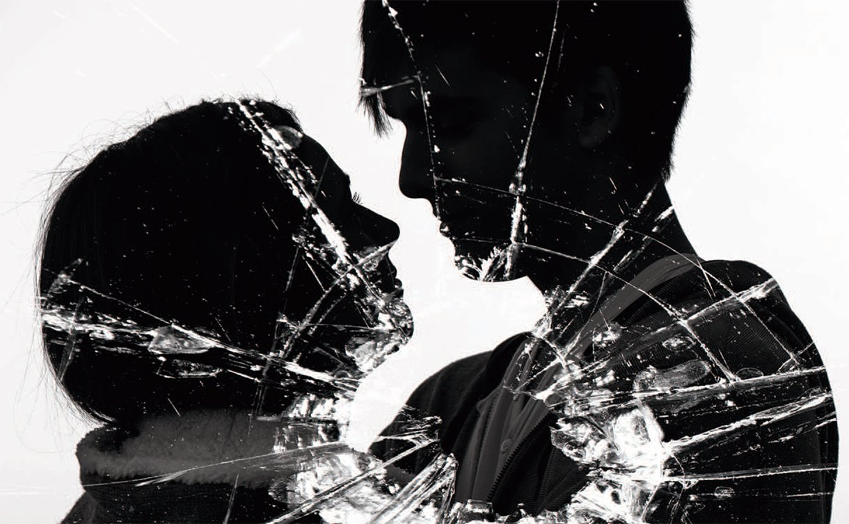 A drawing of a silhouette of a man and a woman embracing with shattered glass in front
