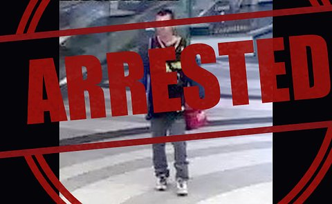 A man in a mall with the word arrested overtop