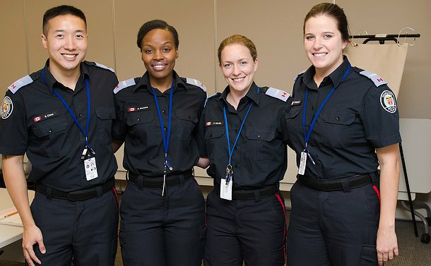 Four cadets, three women and one man in polio constable uniform with cadet patches.