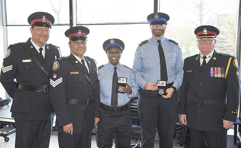 A group of men and women in TPS and TCH uniform