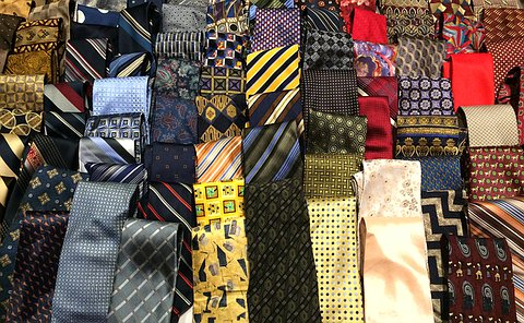 A table full of neatly folded ties