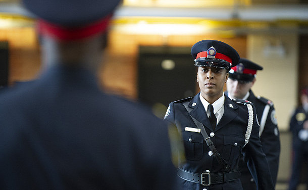 A woman in TPS uniform marching
