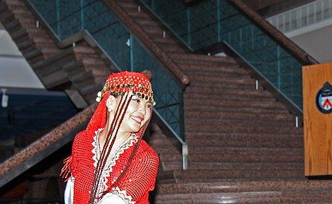 A woman in elaborate costume dances
