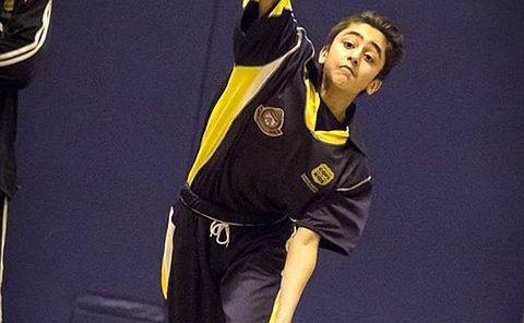 A boy throws a ball