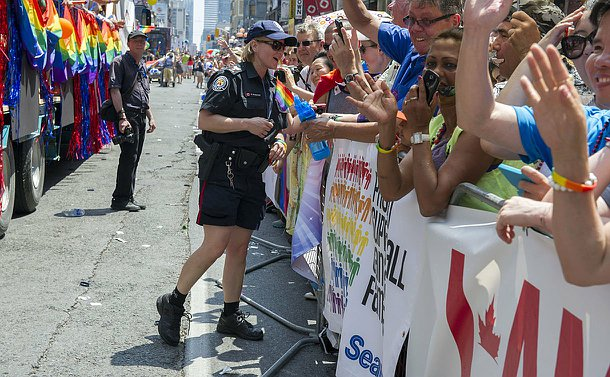 TPS Officer engaging with the crowd at the 2014 World Pride Parade.