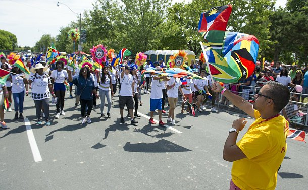 A group of people walking with flags