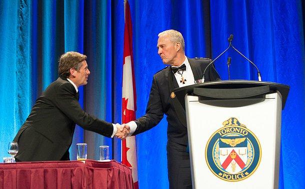 The Chief is dress uniform tuxedo shaking the mayors hand