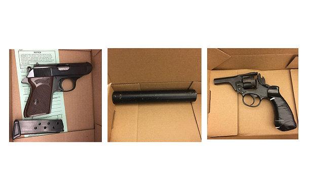 Two handguns and a  silencer