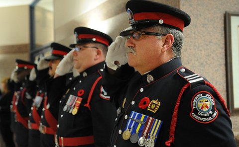 Men in TPS uniform saluting