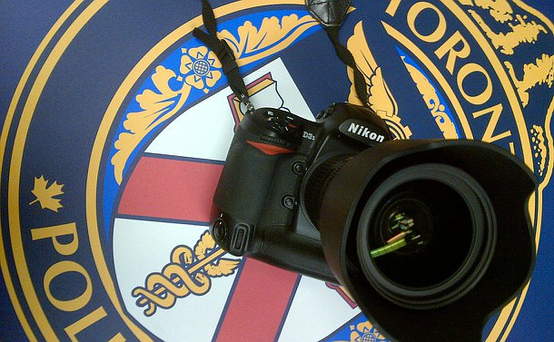A camera against a TPS logo