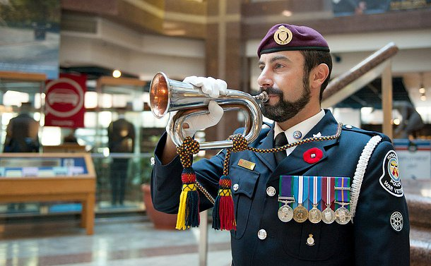 A man in TPS uniform holds a bugle