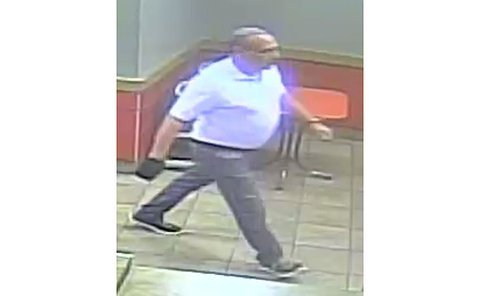 Man with a white shirt walking in the diamonds fraud investigation