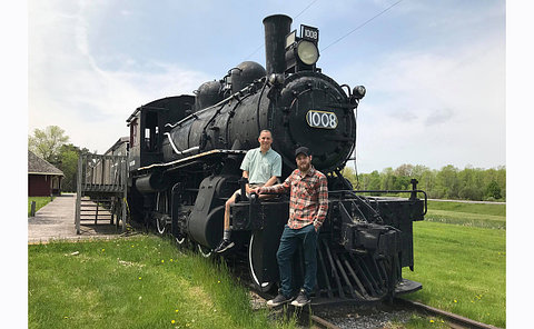 Two men on a train locomotive