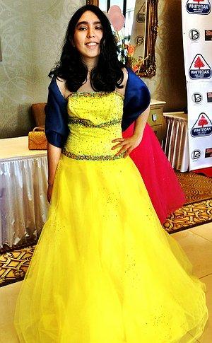 A teenage girl in a yellow dress