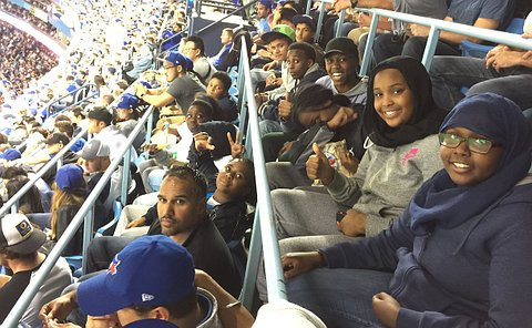 Youth sitting at the jays game.