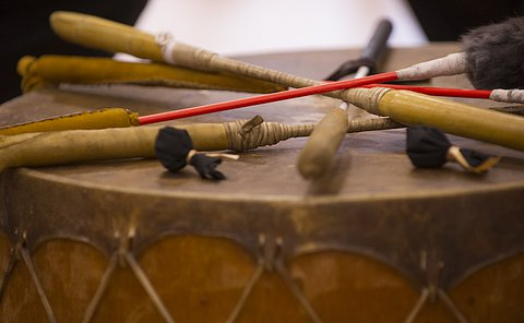 A drum with drumsticks atop it