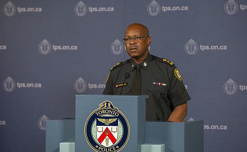 A man at a podium in TPS uniform