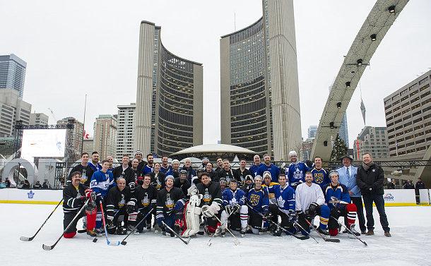 People in hockey uniform on ice