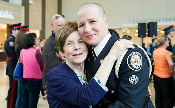 A woman in police uniform with her mother