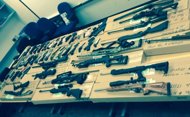 Several tables with guns laid across