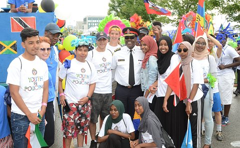A group of teenagers with a man in TPS uniform