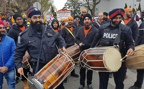 TPS officers playing the drums at the Khalsa Day Parade.